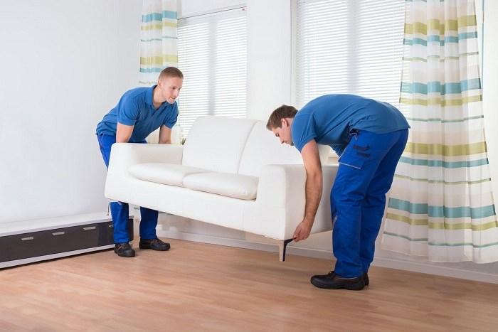 Movers lifting sofa